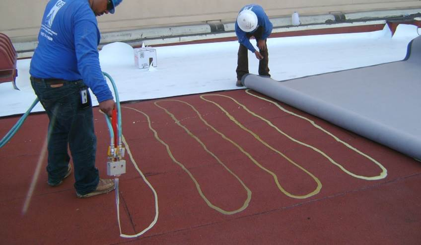 Single ply commercial roofing adhesive.